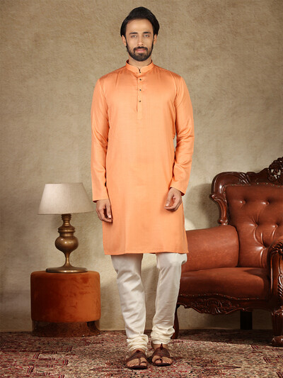 Orange hue solid cotton fabric kurta suit