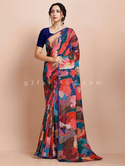 Printed pink party wear georgette sari