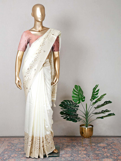 Raw silk cream designer saree for wedding