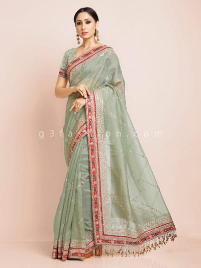 Reception wear pista green premium tissue saree