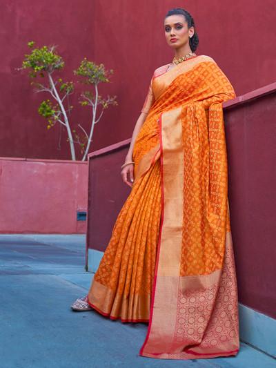 Stately yellow banarasi bandhej silk saree for wedding functions