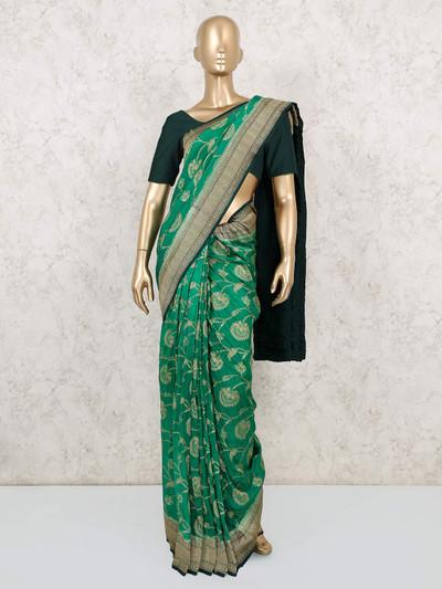 Thread weaving teal green Muga silk saree for weddings
