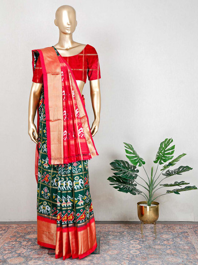 Wedding wear green and red saree in patola silk