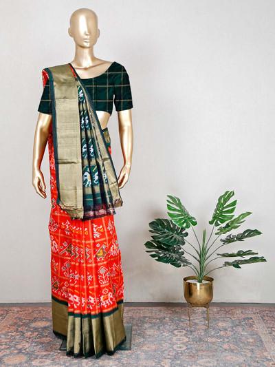 Wedding wear orange and green patola silk saree