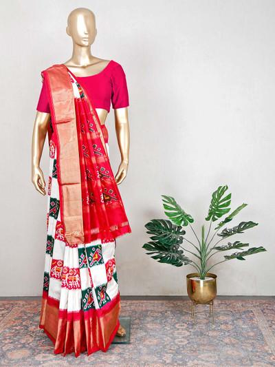 White festive wear saree with zari thread details