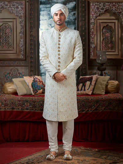 white sherwani with golden button placket