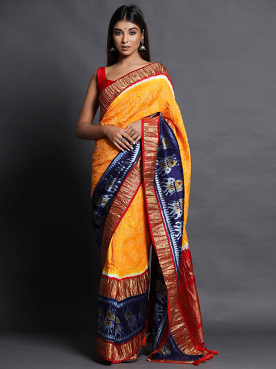 Yellow festive wear saree in bandhej silk
