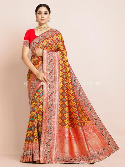 Yellow patola silk reception function saree