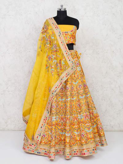 Yellow semi stitched lehenga choli in silk wedding