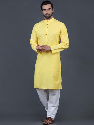 Yellow solid cotton kurta suit for festive wear